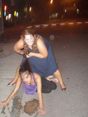 Girl helping some asian chick as she pukes ;D .... !! vomit