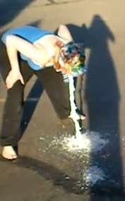 Girl pukes massively on street vomit
