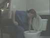 Sitting next to the toilet vomit