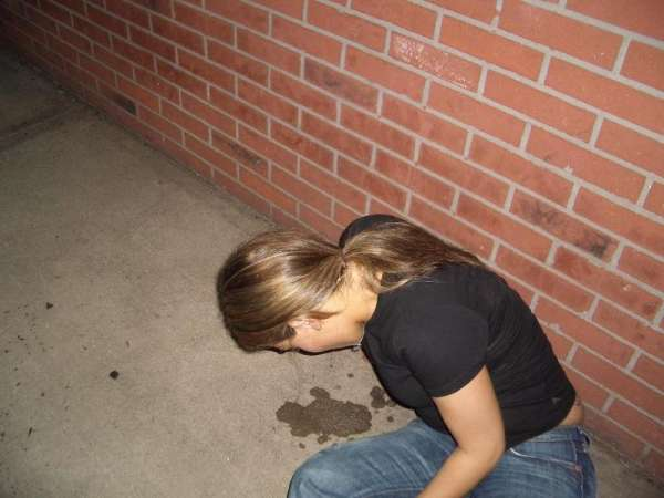 Girl sitting and puking! vomit